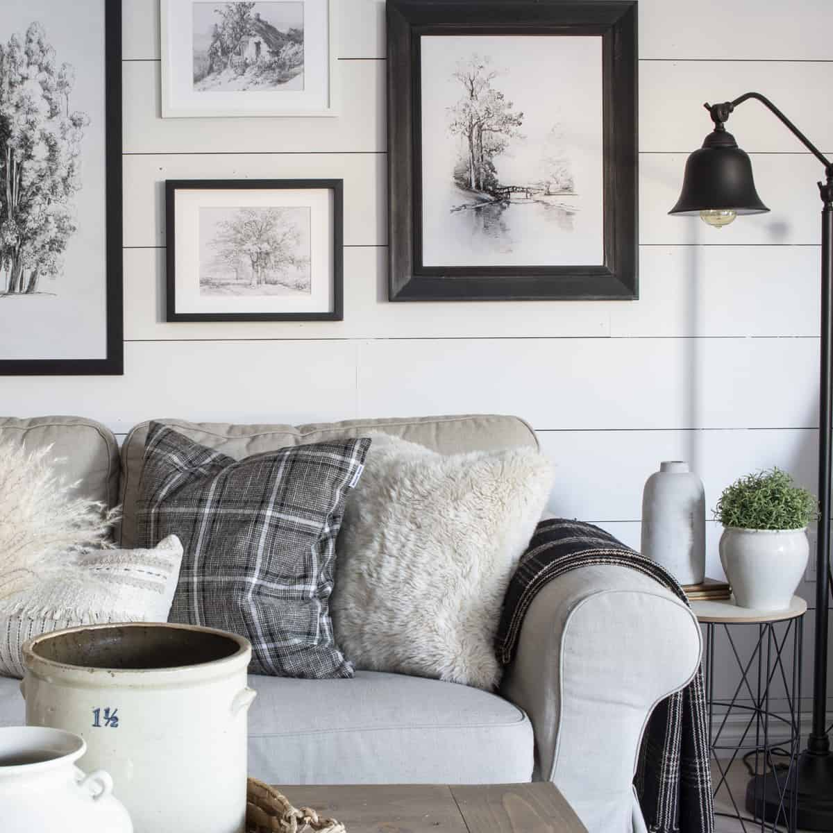 beige sofa black and white gallery wall