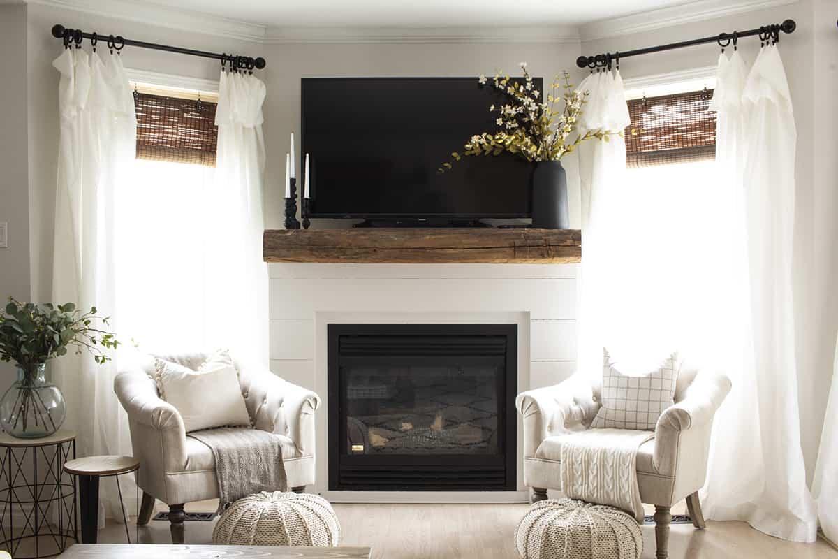Shiplap fireplace barn beam mantel tv above