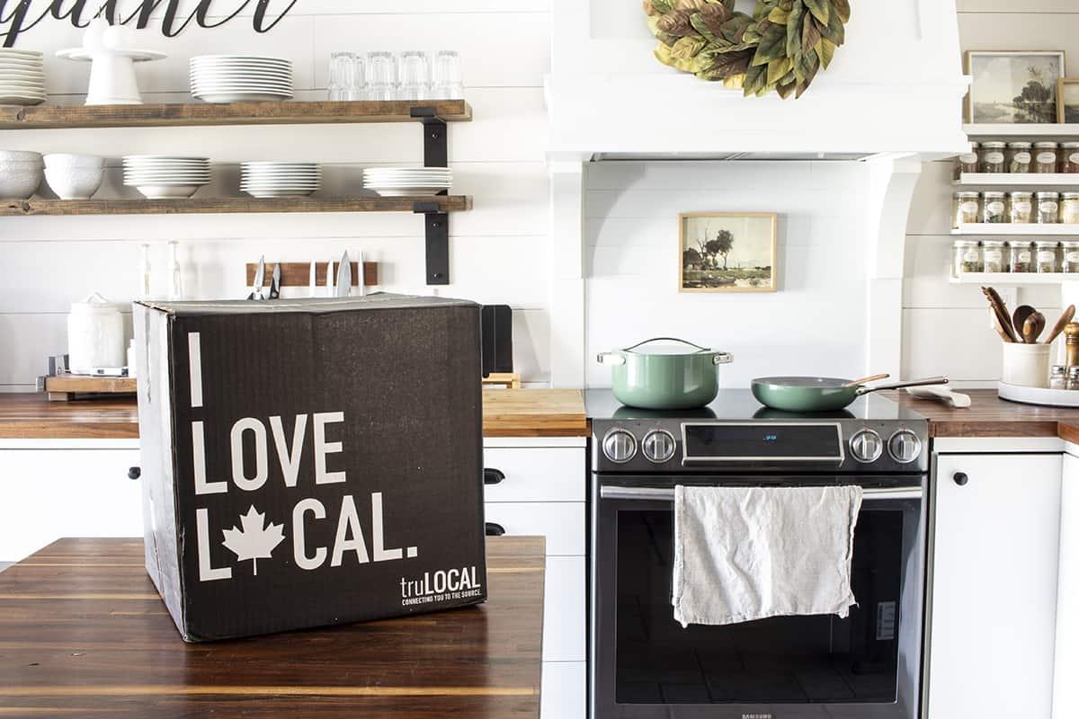 trulocal box on butcher block counter in kitchen