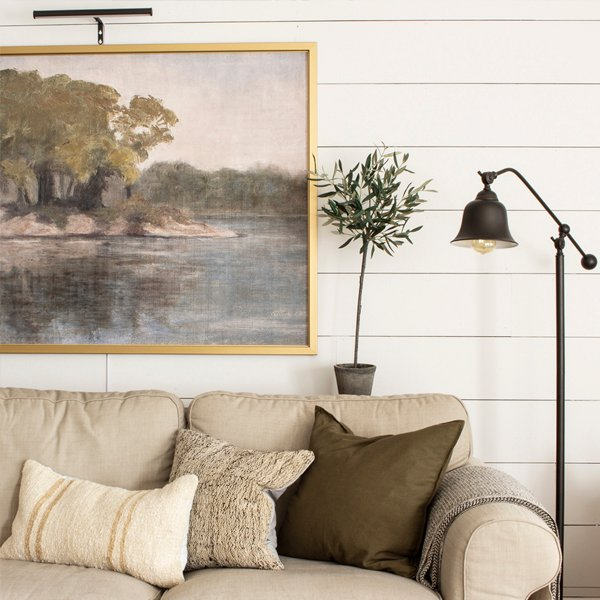 neutral living room lakeside painting olive pillow