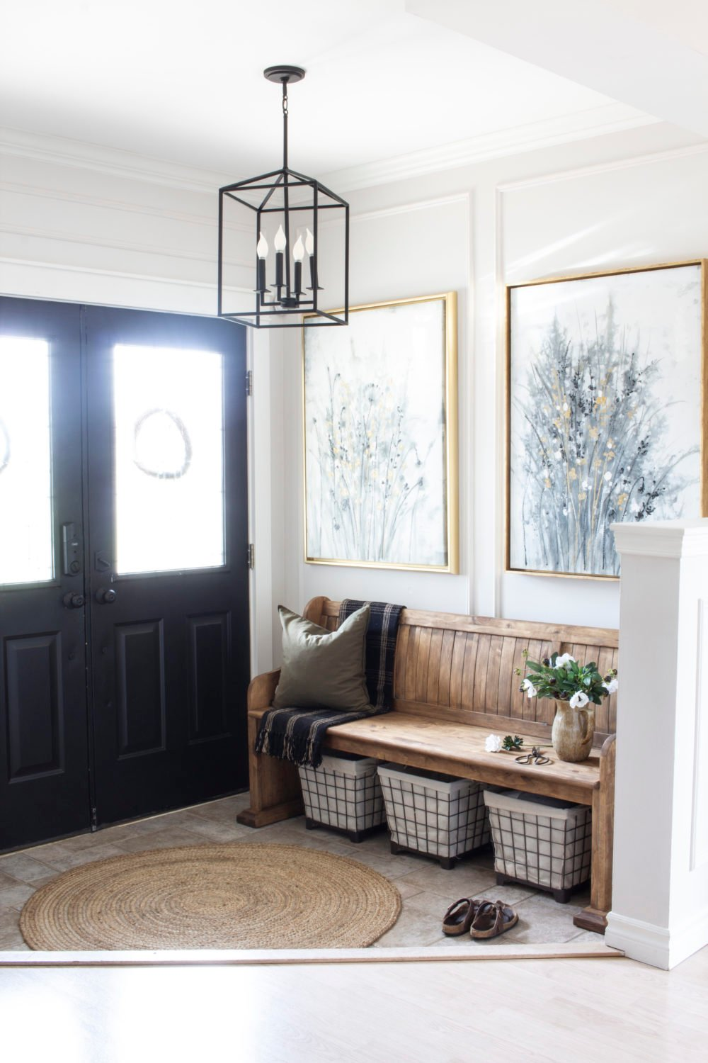 entry from hall wood church pew black doors gold framed art