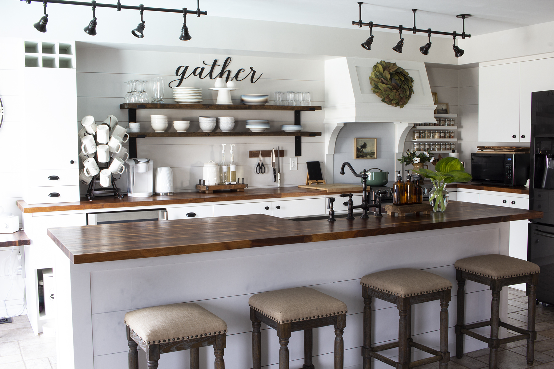 white farmhouse kitchen with huge island butcher block counters