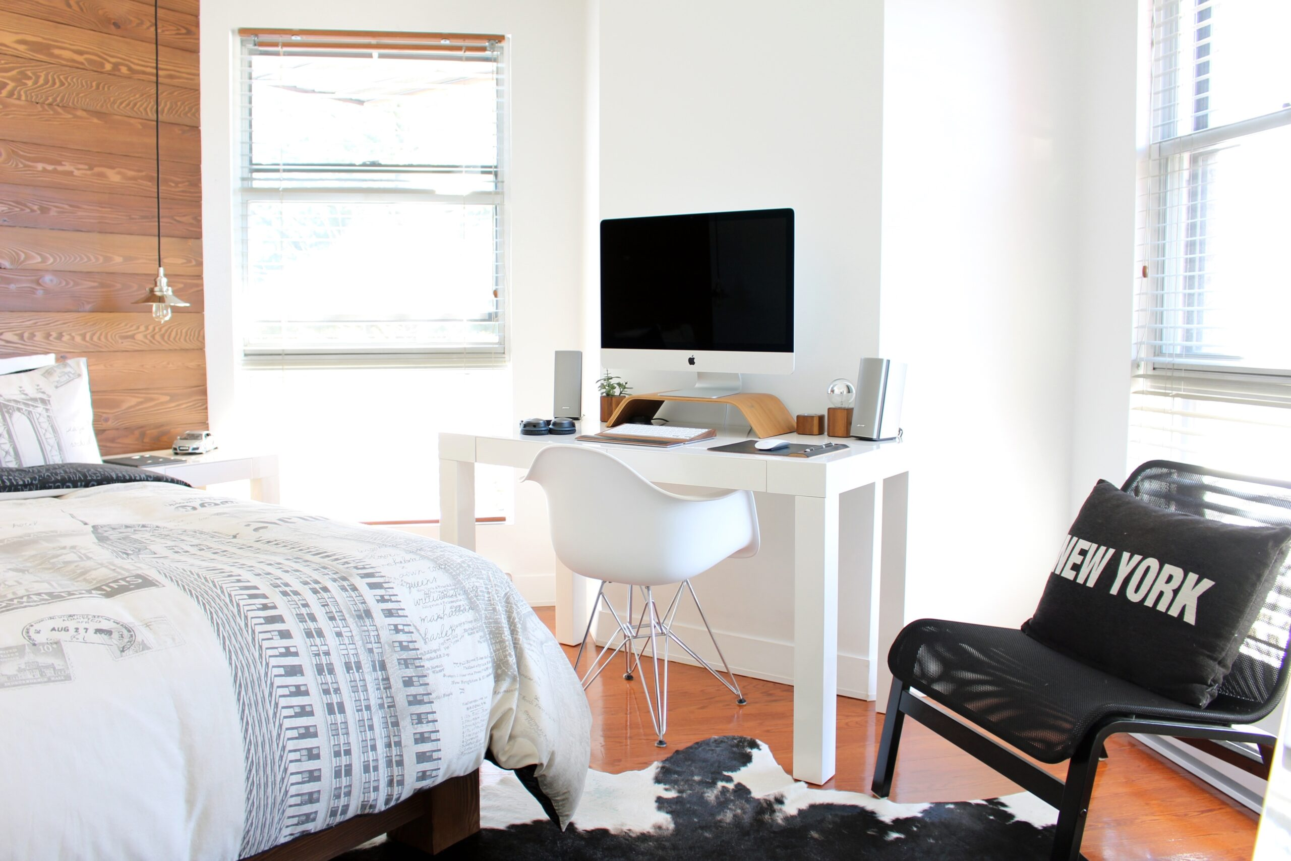 dorm room with two windows