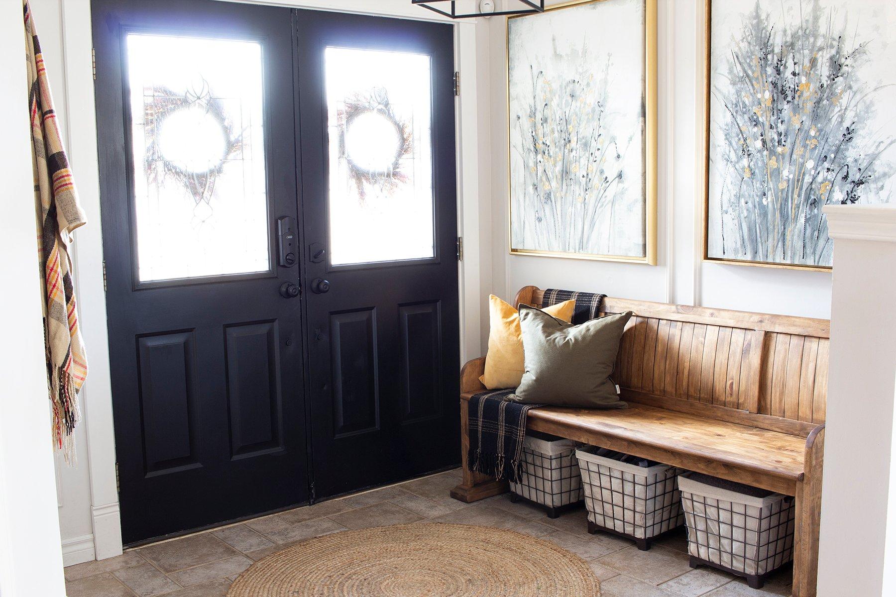 cozy entryway with black double doors