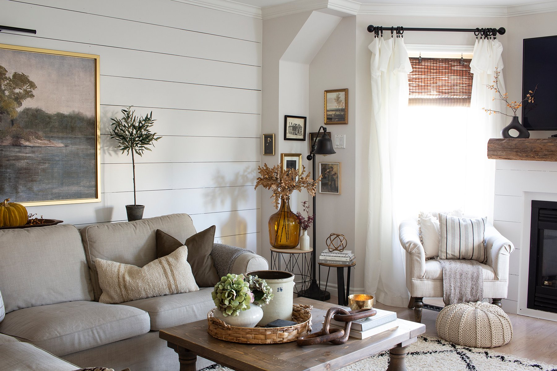cozy living room corner with vintage art gallery wall