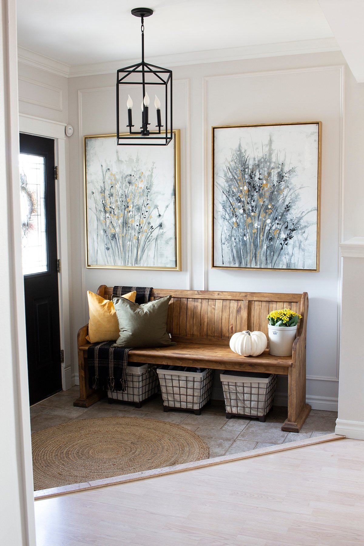 fall entryway with church pew and gold framed art