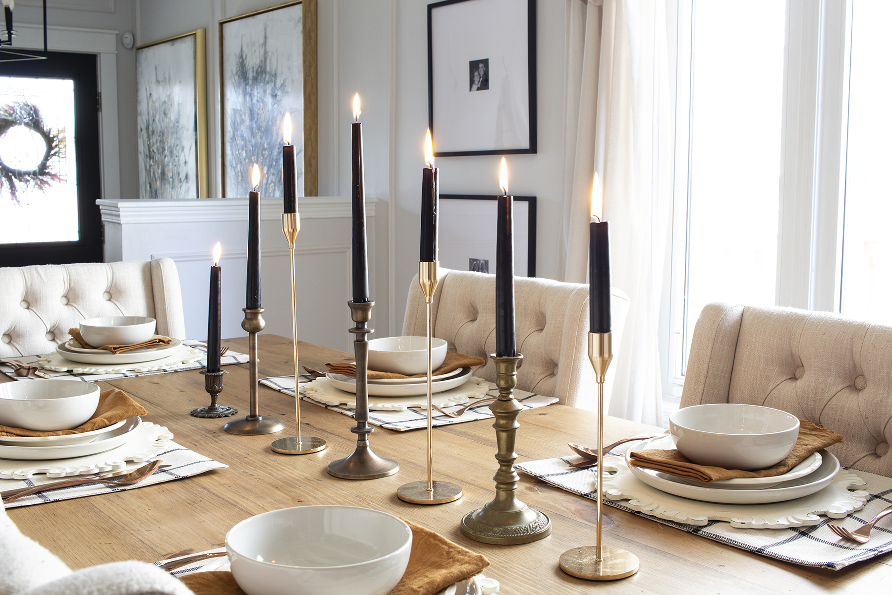 new and brass candlesticks with black taper candles