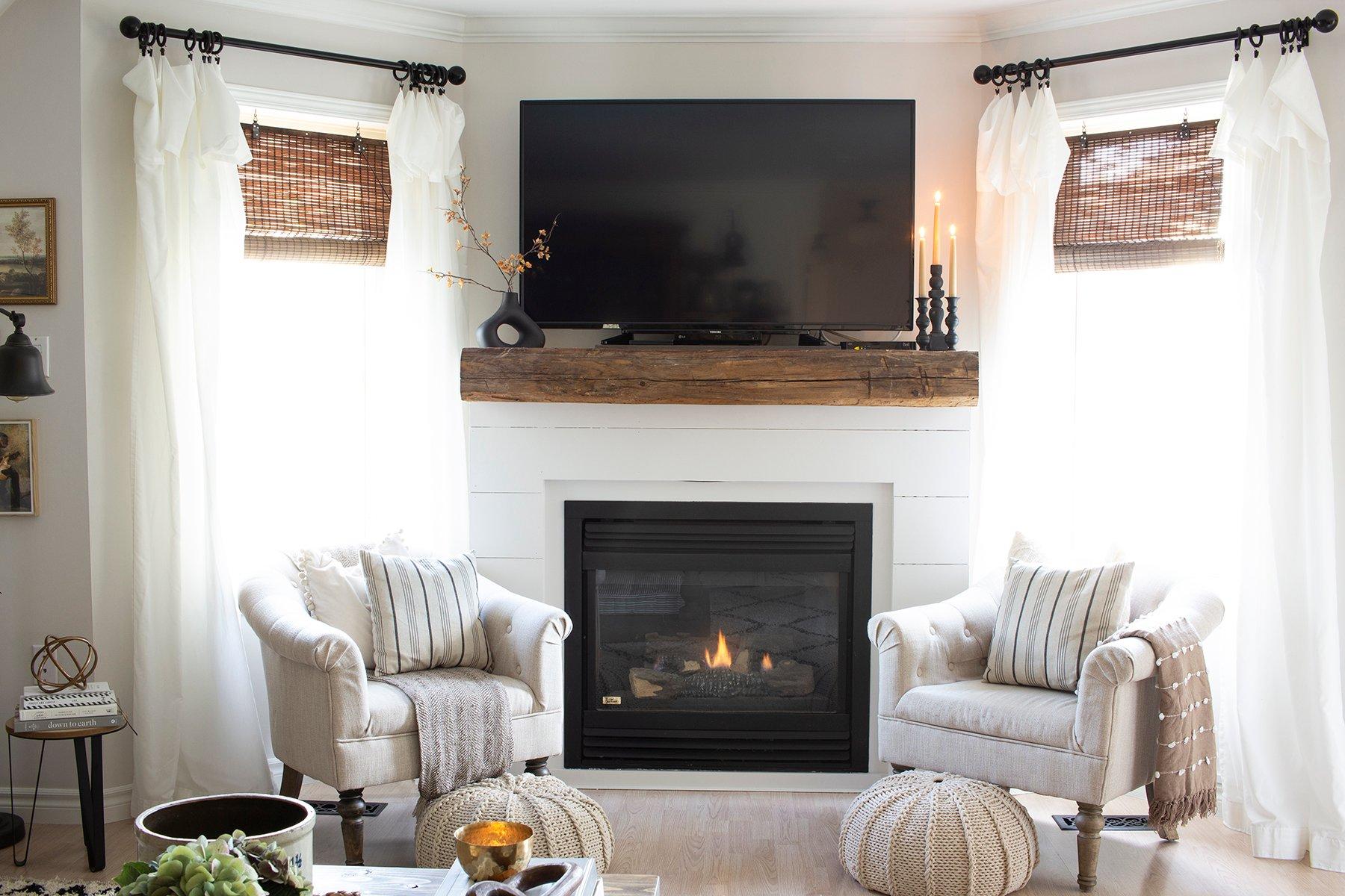 white shiplap fireplace wood barn beam tv above fall