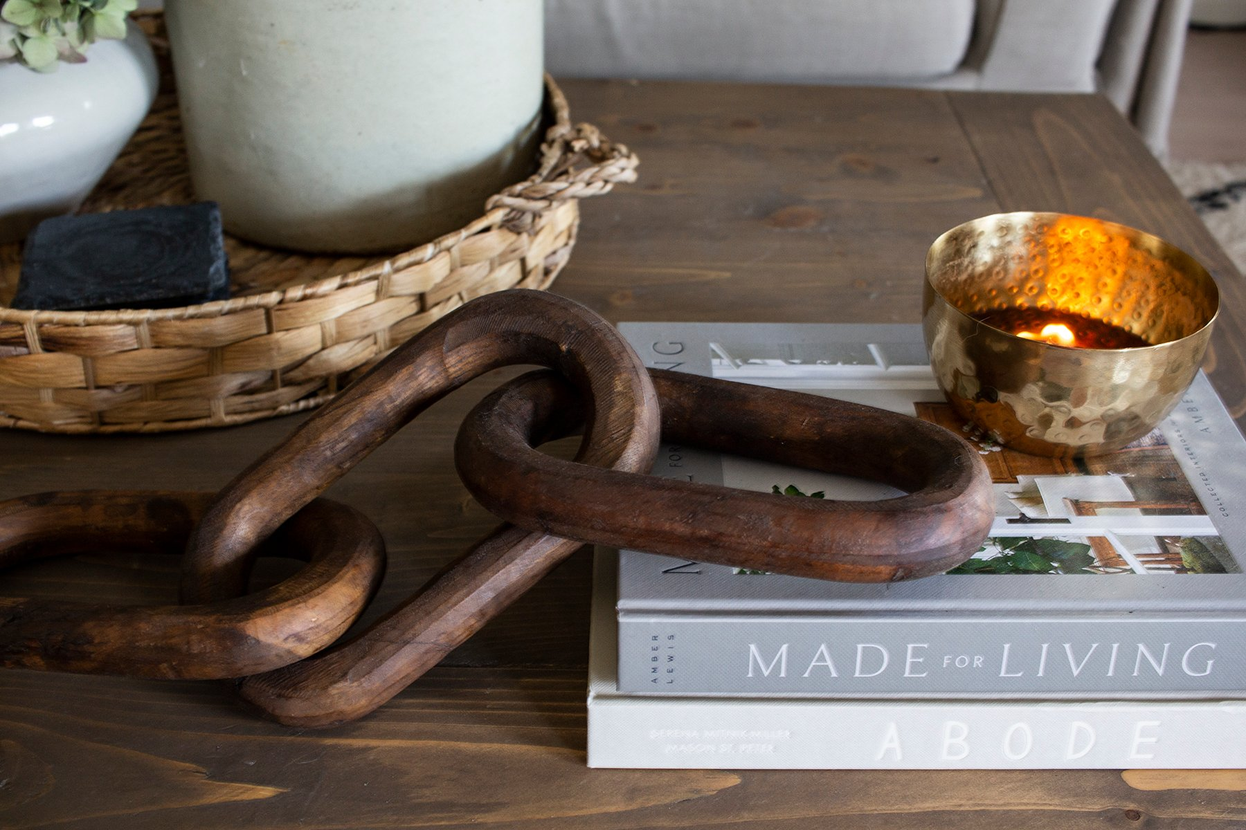wooden links basket candle on coffee table